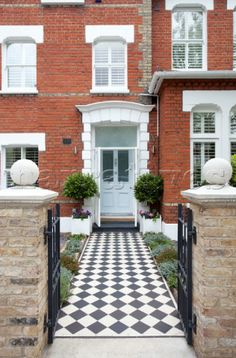 Original entrance path to front door of red brick London home UK
