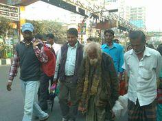 Sufi Dervish Haider Shah and his followers in the street is Dhaka, Bangladesh.