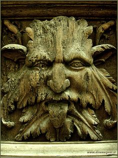 www.diramazioni.it Fauno, faun, uomo verde, green man, horned man, ancient symbol of woods, seen nowadays in many architectures. Taken in Foligno, it was carved in a wooden door.