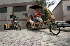 Chris Tress and his wife, Florence Tress, drive bamboo electric tricycles that they designed themselves, in Shanghai, June 25, 2012. [Photo/Asianewsphoto]
