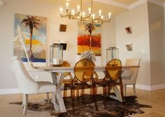 Dining Room Chandelier Painting White Dining Table Candle Holder Sconce Animal Print Carpet Brown Dining Chair Wooden Floor Dining Room versus No Dining Room: Which one is better?