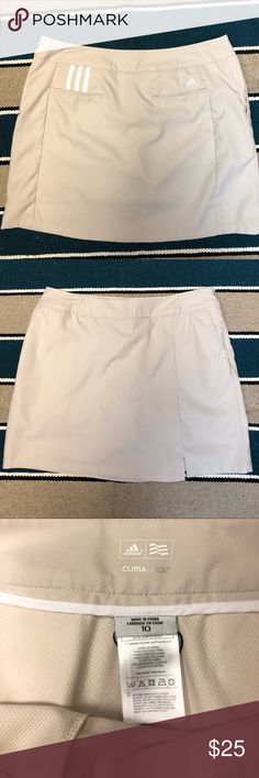Women's adidas tennis skort Women's adidas tennis skirt size 10. Synthetic material. Like new. Has the shorts build in! adidas Shorts Skorts