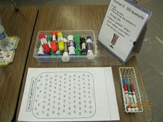 """Student used Bingo paint dabbers to find and identify the numbers 1 to 100 in chronological order and then make a """"gumball"""" in the jar by stamping the number."""
