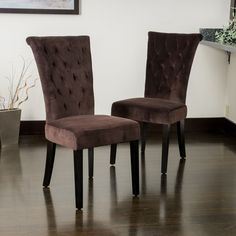 This set of two dining chairs offers a dark chocolate upholstery design that will add style and elegance to any room. The sturdy construction and velvety soft material will have your guests sitting in luxury.