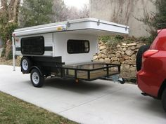 Tow behind truck bed with camper.