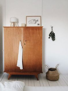 scandinavian-inspired bedroom decor with wood wardrobe cabinet. / sfgirlbybay