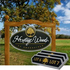 A Minnesota developer wanted something a little different for his subdivision sign. Strata came up with the idea of using a single-sided hanging entrance sign, rigidly mounted to a custom arched cedar framework.  This subdivision entrance sign incorporates the project's tree logo and script text. The richly carved tree in metallic gold set against a black background adds an extra bit of elegance. #hangingoutdoorsigns #subdivisionsigns #customsigns