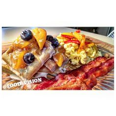 Breakfast: Eggs Toped w/ Sauteed Peppers & Bacon Serve w/ Waffles Covered w/ Cinnamon Peaches, Blueberries & Frosting!