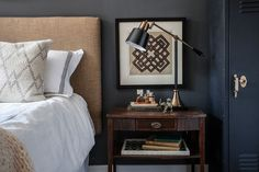 Shades of Gray // a dee charcoal wall color adds dimension and drama to the eclectic design elements