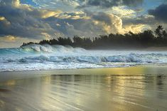 Haena Surf - Kauai, Hawaii As the sun rose, a storm brings big surf to the north shore of the island of Kauai.