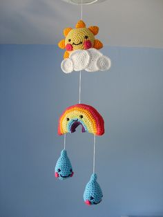 Crocheted Mobile with Cloud, Sun, Rainbow and Raindrops - Free Crochet Pattern here: http://www.coatscrafts.co.uk/NR/rdonlyres/E861300B-0591-44C7-A5BF-0F24218A2F74/62206/CT_Mobile.pdf