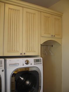 Hanging rod that I can reach! I like the location, right next to the dryer, and the cabinets above...good use of space.