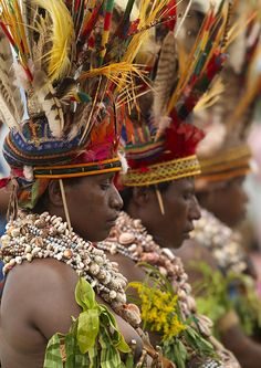 """Once a year takes place in Mount Hagen the biggest tribal meeting, called a singsing. The """"Men bilong pait"""" (the Warriors) ,the"""" pipels"""" (the women), and the """"pikinini"""" (the children) are all here. Hundreds of papus are preparing in open air, as men paint their faces in red,yellow,white,black, women take grass to make skirts or kilts and cover their bodies with clay, mud, or even pigs fat!"""