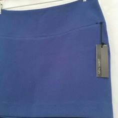 """Express Royal Blue Mini Dropped waist with foreign joke, mini skirt. Fully lined, invisible side zipper.  64% poly 33% rayon 3% spandex 100% poly lining  33"""" waist 40"""" hips 38"""" sweep Express Skirts Mini"""