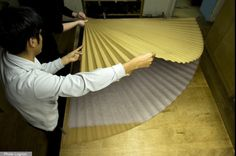 """MAISON LOGNON 3 ~ Haute couture specialist in pleating. For a """"plissée soleil"""" sunburst pleat, the fabric is placed on a mold then run through a heating press."""