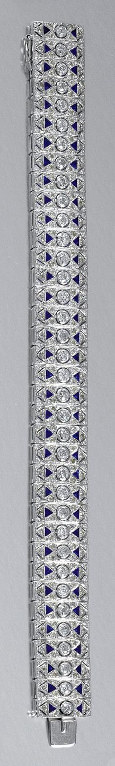 ENAMEL AND DIAMOND BRACELET Designed as an articulated series of rectangular links, each millegrain- and collet-set with circular-cut diamonds accented with blue enamel, length approximately 195mm.