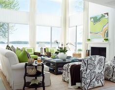 Of course it's the windows that totally make this room but I also love the huge black and white leaf print on the chairs and the hits of green.    The other thing that makes this room great is that the wall colour in no way takes away from the view.