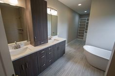 Large master suite with a double vanity. Freestanding tub. Walk in closet with custom shelving.