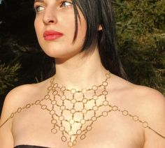 Hey, I found this really awesome Etsy listing at http://www.etsy.com/listing/124657329/queen-bee-geometric-body-chain