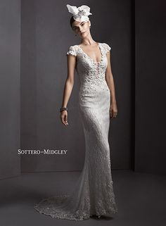 Sheath wedding dress with three-dimensional floral appliques and sparkling Swarovski crystals with dramatic plunging neckline and illusion cap-sleeves, Ambria by Sottero and Midgley.