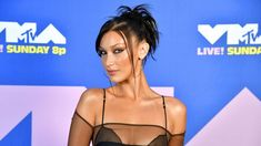 2020 MTV VMAs: Bella Hadid leaves little to the imagination in sheer shirt | Fox News Mtv Video Music Award, Music Awards, Wag The Dog, Bella Gigi Hadid, Hot Goth Girls, Mtv Videos, Legally Blonde, 90s Hairstyles, Sheer Shirt