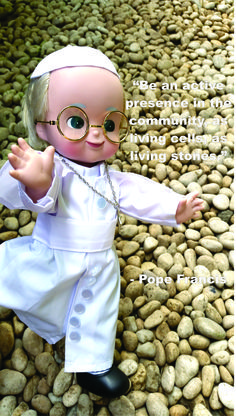 Pope Francis' religious quote on the Church and the community being living stones featuring pebbles. Photo by Romana K. Go