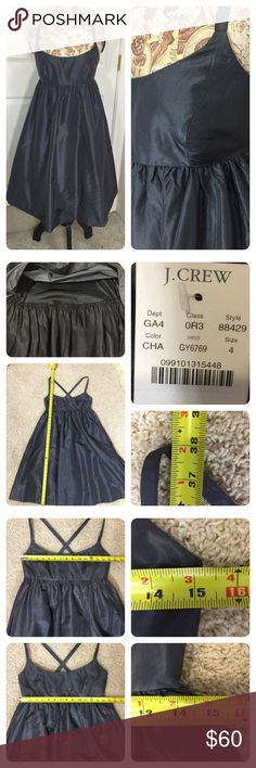New wit tags J CREW SILK TAFFETA BALLERINA DRESS New with tags. Dramatic and sophisticated in lightweight silk taffeta. Fitted bodice with cross back straps. Side pockets. Full skirt with lining - ruffled at bottom ( see pic 2).  No size or material tag, but info on price tag ( size & style number ). J. Crew Dresses