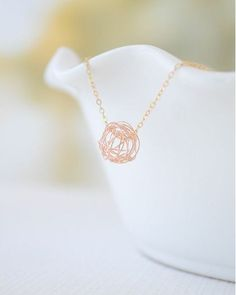 Ball of yarn necklace gold