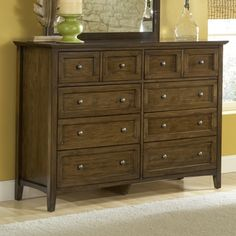 @Overstock - The design of this dresser features clean lines and updated styling for a fresh take on classic Shaker furniture. Crafted of mahogany solid wood with a rich truffle finish, this dresser is fitted with premium, full extension ball bearing drawer glides. http://www.overstock.com/Home-Garden/Modern-Shaker-8-drawer-Mahogany-Dresser/7637260/product.html?CID=214117 $953.99
