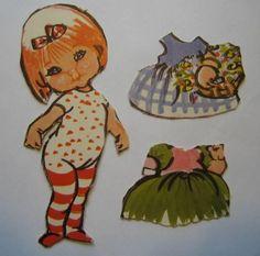 Christel pige med rødt hår og stribede strømper