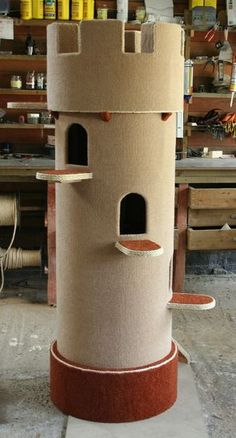 1000 ideas about cat playhouse on pinterest cardboard for Diy cat tower cardboard
