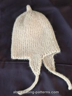 The only thing cuter than a baby is a baby in a hat. The Tiny Earflap Hat is an adorable little knit you and your little munchkin will love. This cute knit hat pattern is a surefire way to keep baby warm in style all winter long. Baby Hat Knitting Patterns Free, Baby Hat Patterns, Baby Hats Knitting, Knitting For Kids, Free Knitting, Knitted Hats, Knitting Projects, Crochet Shoes Pattern, Mittens Pattern