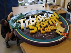 DISPLAY SIGNAGE CNC CUT 3D TROPICAL STORM CAFE at LONGLEAT SAFARI PARK. 3D modelled here at The Grain on Artcam and then 3D milled from High Density Foam our our CNC router. Colour was then applied by air-brush in layers.