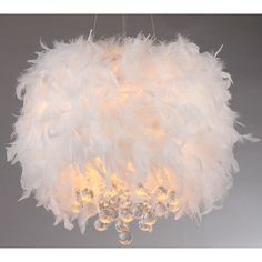 Show your unique taste with this Iglesias pendant featuring three lights glamorously placed under a curtain of feathers and crystals. A chrome finish ensures that this indoor pendant can bring light into a variety of decors.