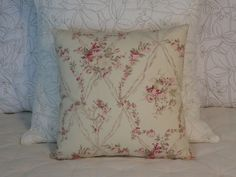 This 17 x 17  pillow is created from a sweet floral print on 100% cotton. Created from Amadeus Floral fabric, a fine-textured smooth cotton with a vintage reproduction print from American Folk & Fabric. Bunches of flowers, roses, ribbon garlands, and musical instruments in shades of pink and tan on a warm cream colored background. Looks like vintage wallpaper! Same fabric on the back, different part of the print. Hidden zipper closure. Multiples of this pillow, if still available, may…