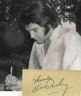 Elvis writing thank you note.