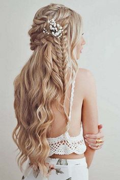 this wedding hairstyle is so beautiful with the braided element and flower…
