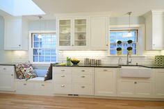 Kitchen Remodel - window seat, farm sink, white cabinets, matching panel dishwasher