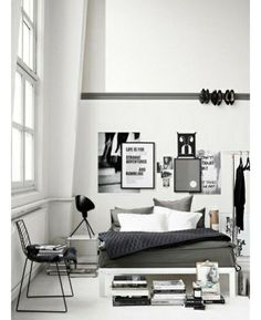 """""""... currently crushing hard on the bold trend that's popping up all over Pinterest for monochrome homes.      The accent can waiver between white or black (with a few grey shades thrown in too), but the overall effect (that you're living in a chic silent movie) is always the same. We especially love the way that completely black and white decor makes the little bits of colour — such as a potted plant or a pile of books — really pop."""""""