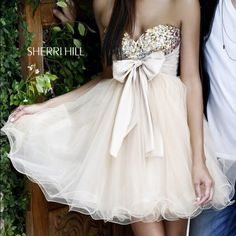 Sherri hill short hold sparkly strapless dress beautiful golden strapless puffy dress perfect for any formal or winter formal or even prom, I never wore it anywhere but there is no clasp just a back zipper Sherri Hill Dresses Strapless