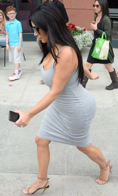 Watch your step! Pregnant Kim Kardashian almost takes a tumble in high heels and tight grey frock while shopping in Beverly Hills