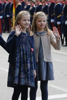 (R-L) Princess Leonor of Spain and Infanta Sofia of Spain attend the National Day Military Parade 2015 on October 12, 2015 in Madrid, Spain.