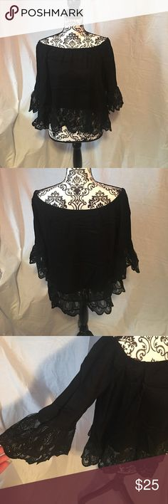 Women's off the shoulder top Brand new women's large off the shoulder too. Black with lace on sleeves and around bottom. Super cute! 100% rayon Tops Blouses