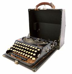 Add this Remington Rand Portable typewriter from the 1920s to your collection! This unique typewriter raises the typebar into a printing position by a lever on the right side of the typewriter. Add th