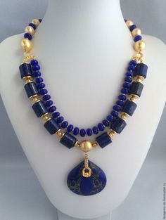 RussianNecklace from natural stones and pearls TRADITION $ 100.08 Materials: natural stones, lapis lazuli, tinted nephrite, pearl majors, gilding 22 carats, accessories of South Korea and USA Size: Length of the necklace with inner diameter 54 cm, lapis lazuli-12x15 mm., Pearl majorka -10 and 12 mm., Suspension - 40х40 m