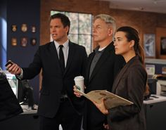 "Case File - Season 10, #13.  The NCIS team investigates a Marine's car accident and ignites some upsetting past memories for Abby as a young girl on the trail of her first ""case,"" on NCIS. Pictured left to right: Michael Weatherly, Mark Harmon and Cote de Pablo Photo: Richard Foreman/CBS ©2012 CBS Broadcasting, Inc. All Rights Reserved."