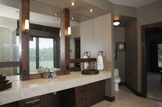 The wood accents in this bathroom are gorgeous!  #bathroom #winnipeg #design #style #cabinet