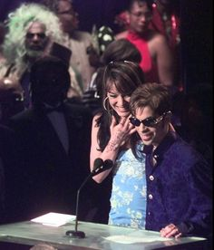 The Artist Formerly Known as Prince, right, introduces George Clinton and the Parliament-Funkadelic for induction into the Rock and Roll Hall of Fame Tuesday, May 6, 1997, in Cleveland. (Credit: AP/ AMY SANCETTA)