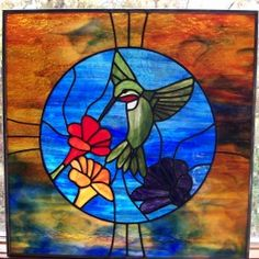 Stained glass hummingbird Gallery ‹ Rockledge Glass Design, made with Uroboros, Wissmach, and Youghiougheny