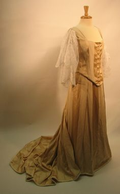 1898 striped silk damask dinner suit, with machine embroidered net sleeves hand mounted to the bodice. Created only as a display piece by As They Sew In France.